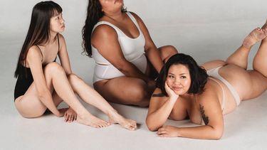 drie vrouwen met verschillende lichamen kijken in de camera
